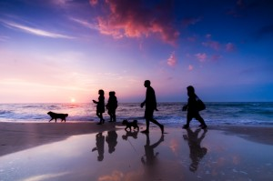 The Miracle Morning Hal Elrod - Family walk on the beach at sunset