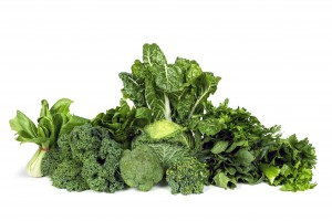 Naturopathy Diet Variety of leafy green vegetables isolated on white background.