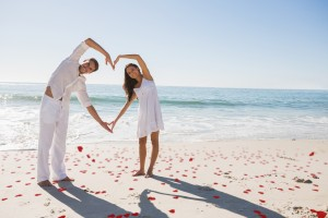 Naturopath Mental Health Mornington  - Love is kindness, giving, mercy, compassion, peace, joy, acceptance, non-judgement, connection, intimacy. - Loving couple forming heart shape with arms against red love hearts