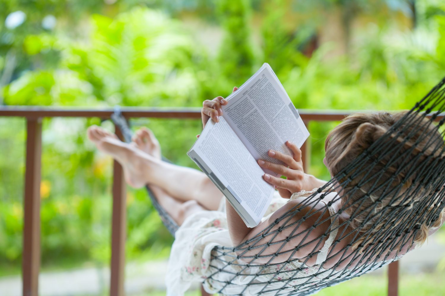 5 Reasons Why Nothing Beats A Great Retreat - Lady reading the book in the hammock